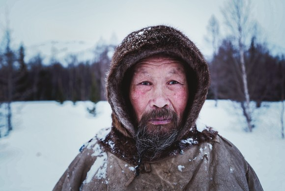 A nenets man stands outside in the snow