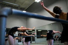 Dancers performing Port-De-Bras at the barre during 2015 summer intensive program