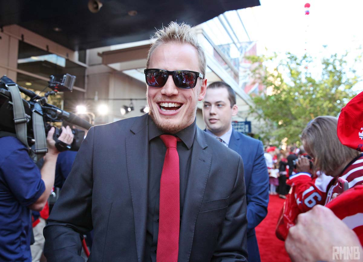 Nate Schmidt, in sunglasses, shares a wide smile