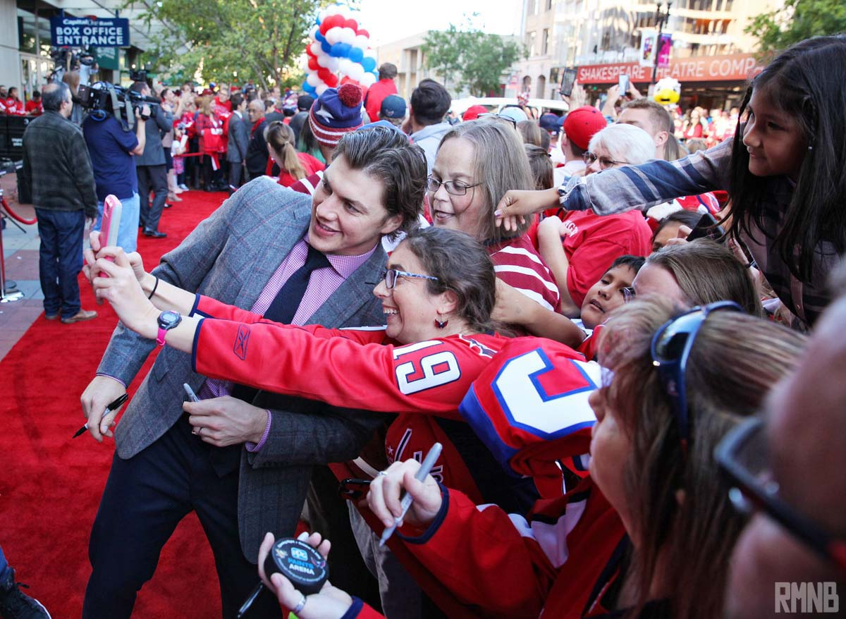 Oshie takes a selfie with a very excited fan