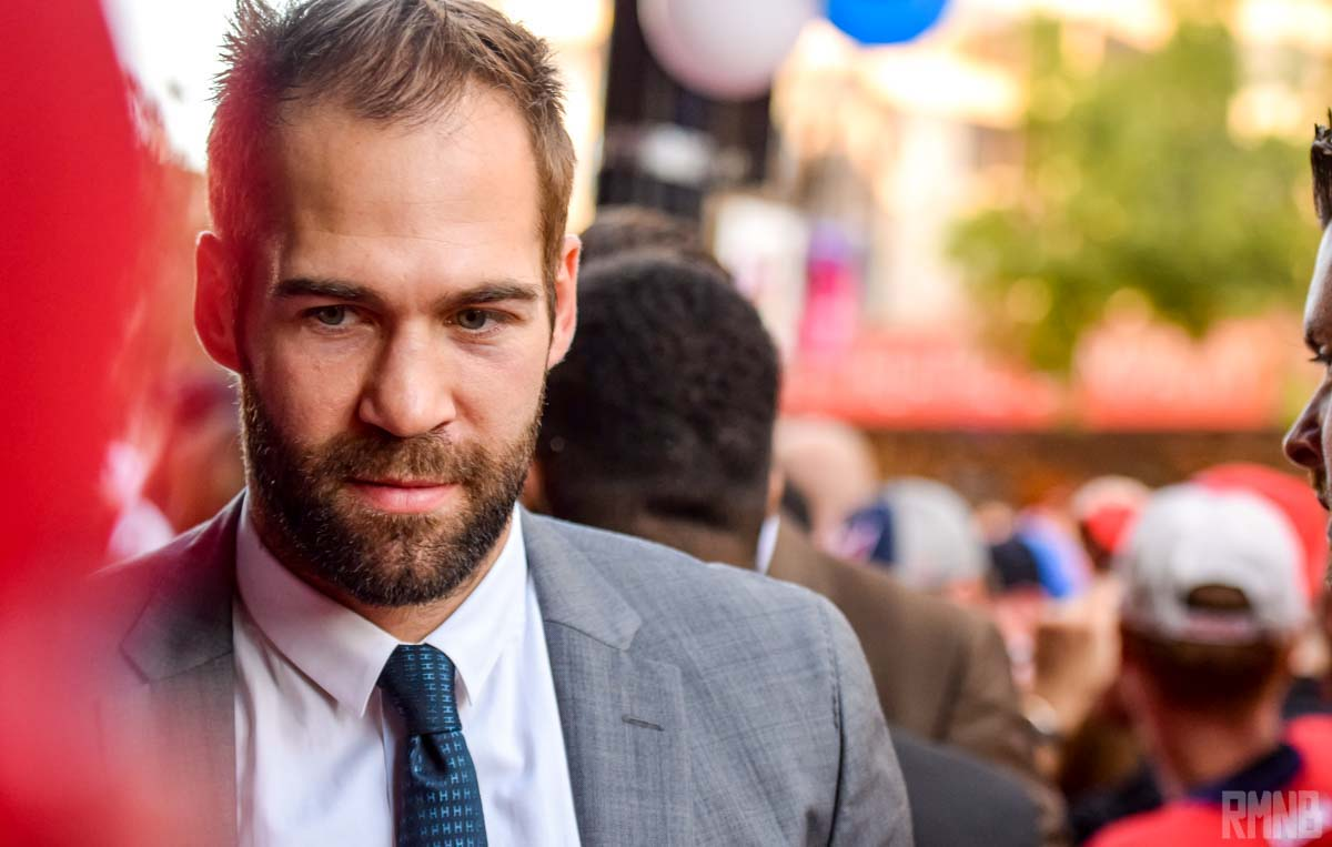 Daniel Winnik arrives in a grey suit