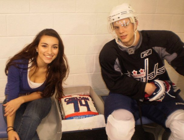 Nour poses with John Carlson after she presents him with the cake
