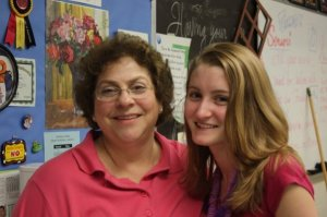 Andrea 'Froggy' Henderson poses for a photo with one of her students.