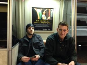 Karl Alzner and Jeff Schultz rid the Metro, look miserable because they are on the Metro.