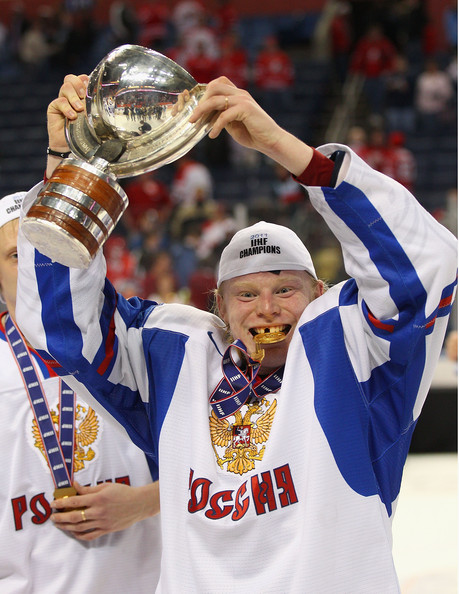 Denis Golubev holds up the WJC Trophy