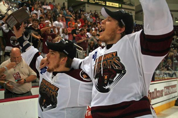 Chris Bourque and John Carlson salute the crowd.