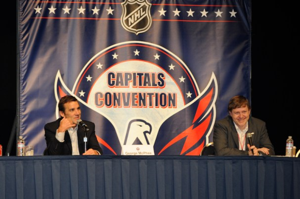 George McPhee and Nate Ewell on stage during a presentation in the morning at the Caps Convention.