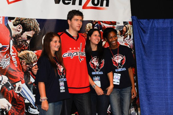 Semyon Varlamov poses for pictures with fans at the Caps Convention.