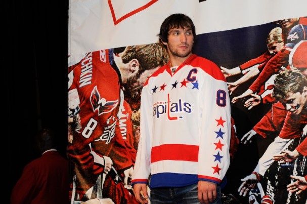 Alex Ovechkin looks on as he awaits to a take a photo with a fan at Caps Convention