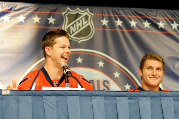Andrew Gordon (left) and Karl Alzner (right) share a laugh during a panel discussion at Caps Convention.