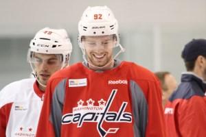Evgeny Kuznetsov laughing during Capitals training camp on Wednesday.