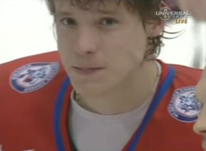 Alex Semin cries after receiving his silver medal.