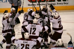 Boyd Kane gets mobbed by his teammates after scoring the GWG in OT. (Photos by Kyle M.)
