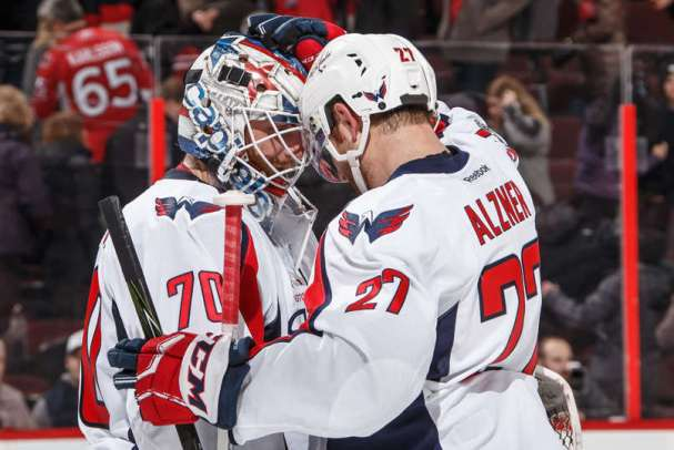 Jason Arnott congratulates Braden Holtby after registering his first NHL shutout