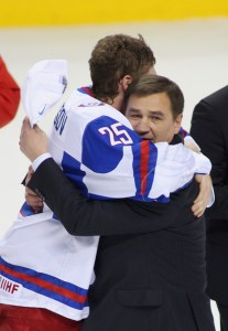 Evgeny Kuznetsov embraces Head Coach Valeri Bragin. (Photo credit: Rick Stewart)