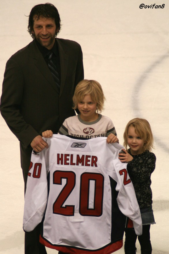 Bryan Helmer and his family on the ice for Post Game Jersey Auction