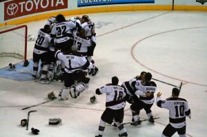 The Hershey Bears mob Michal Neuvirth after the final horn sounds!