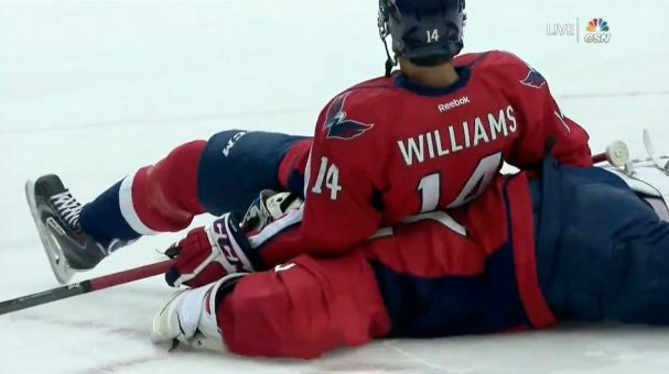 justin-williams-sits-on-braden-holtby
