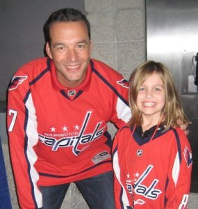 The birthday girl, MacKenzie, poses with Capitals great Olie Kolzig.