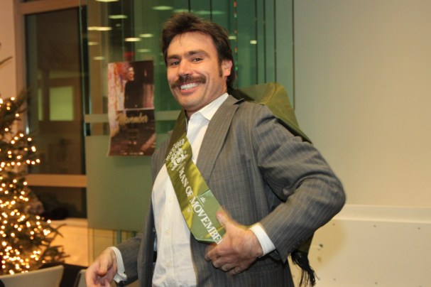 """The """"Man of Movember"""" poses with his lovely sash."""