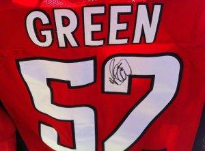 This signed Mike Green jersey will be up for auction.
