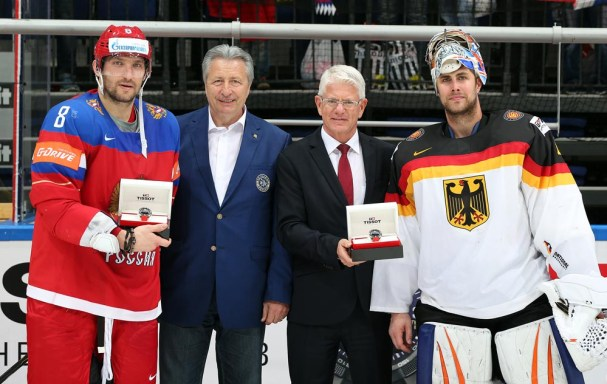 MOSCOW, RUSSIA - MAY 19: Former Soviet National Team player Alexander Yakushev and newly elected IIHF Council Member Franz Reindl present the Player of the Game awards to Russia's Alexander Ovechkin #8 and Germany's Thomas Greiss #1 following Russia's 4-1 quarterfinal round win at the 2016 IIHF Ice Hockey World Championship. (Photo by Andre Ringuette/HHOF-IIHF Images)