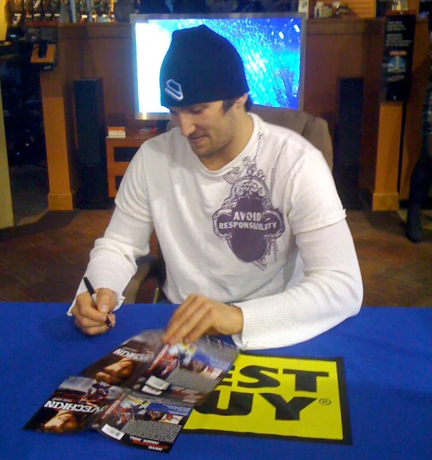 Alex Ovechkin, in his Avoid Responsibility T-Shirt, signs copies of his new DVD at the Sterling Best Buy.