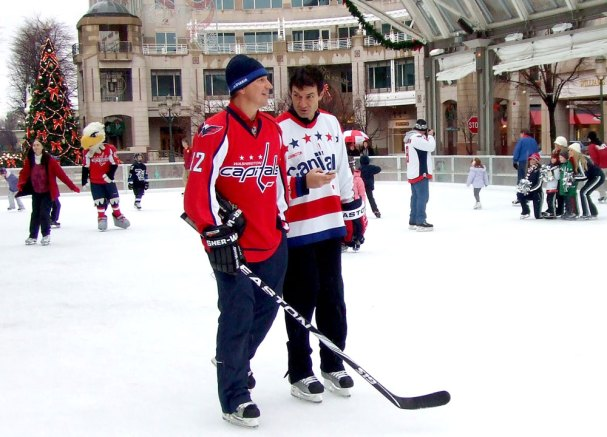 Peter Bondra chats with Alan May at the Reston Town Center skating pavilion.