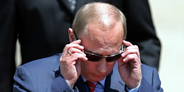 Russia's President Vladimir Putin puts his sunglasses on upon arrival at Zagreb airport, Sunday, June 24, 2007. President Putin is to attend a regional conference on energy in the Croatian capital. (AP Photo/Darko Bandic)
