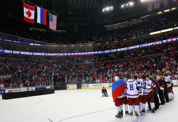 Russia celebrates during the playing of their national anthem