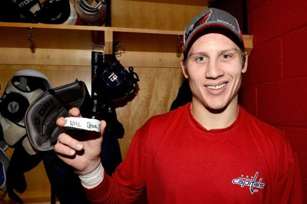 Steve Oleksy holds up the puck from his first NHL goal