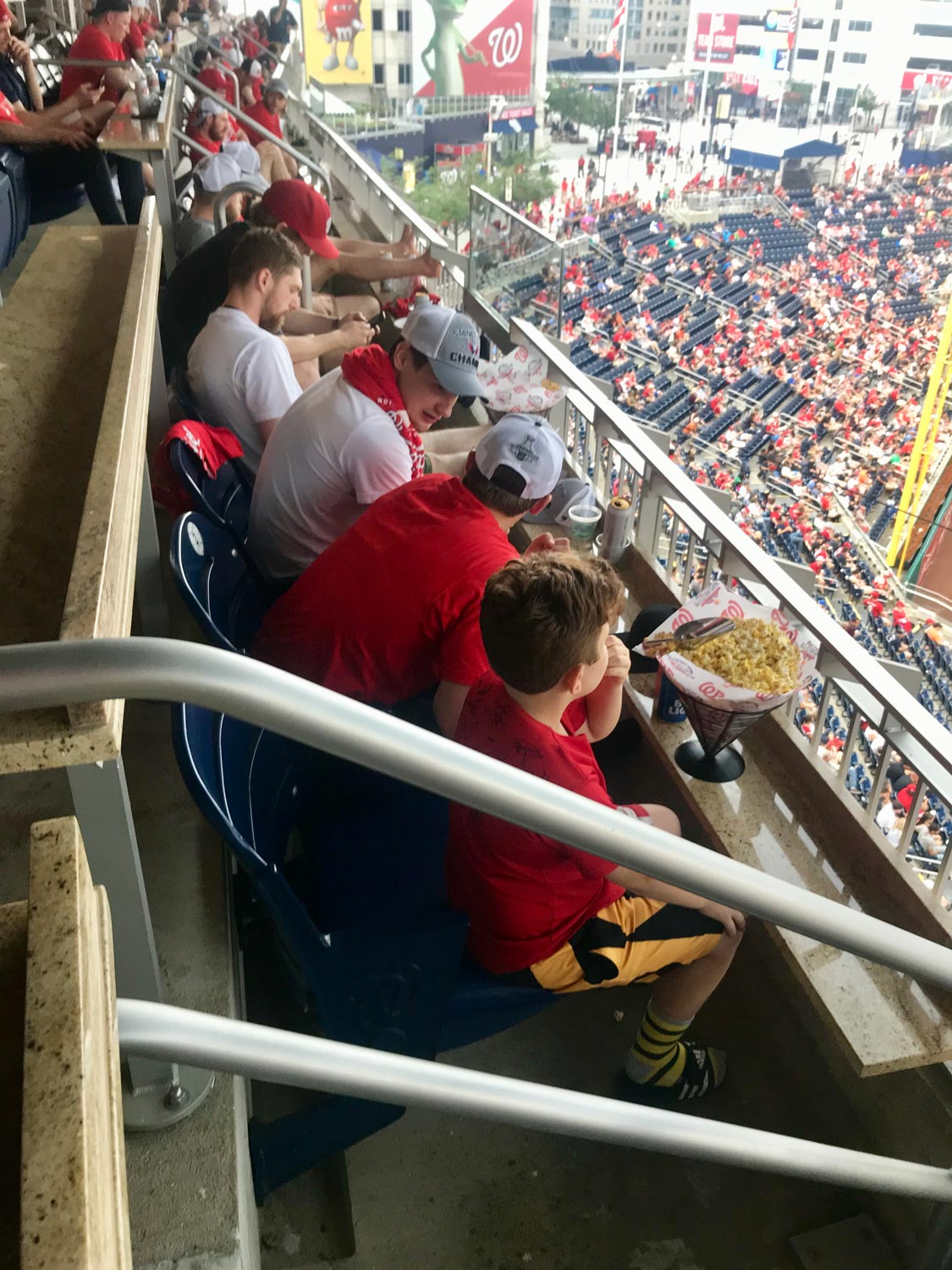 10-year-old sits with Jakub Vrana, Dmitry Orlov, and Evgeny Kuznetsov