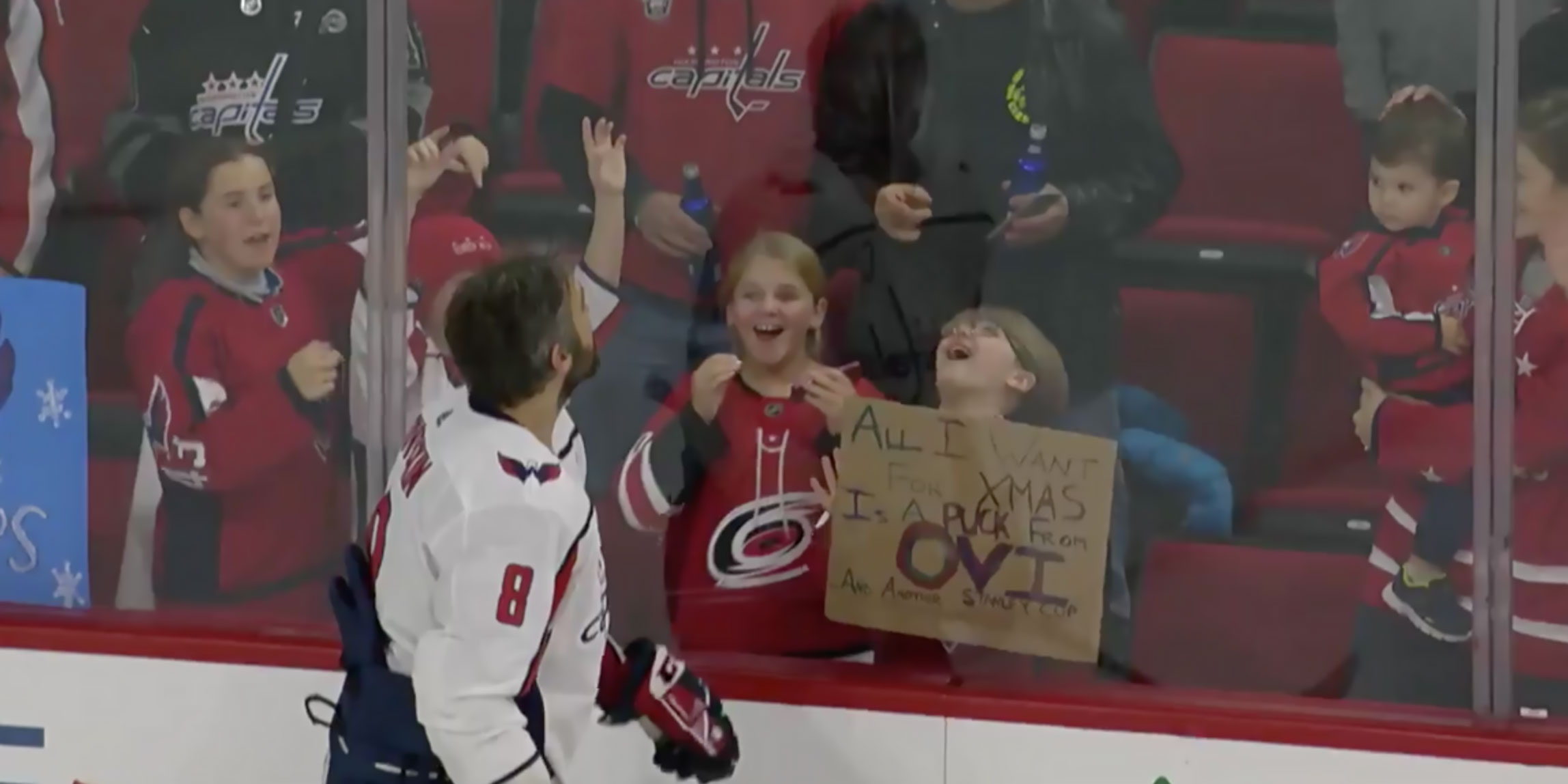 Alex-ovechkin-tosses-puck-to-caps-fan