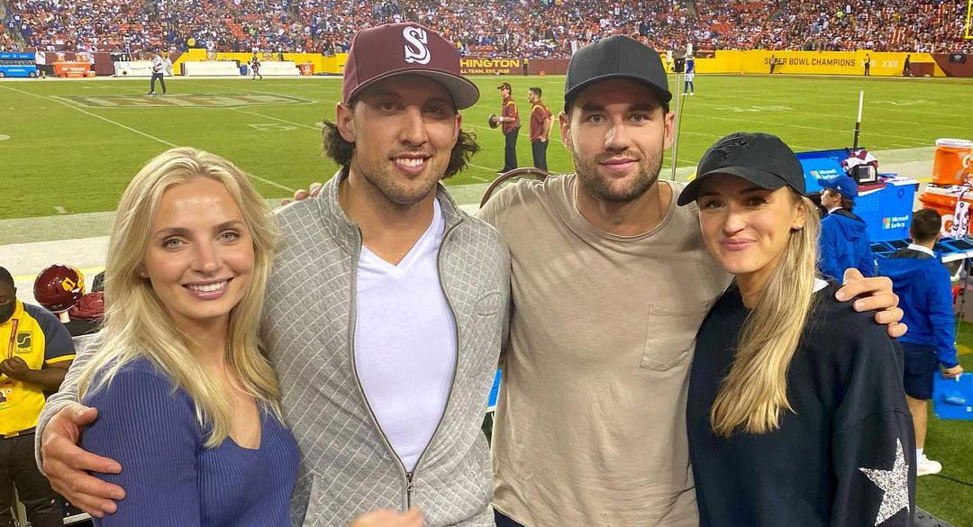 Tom Wilson attends Washington Football Team game with Brenden Dillon