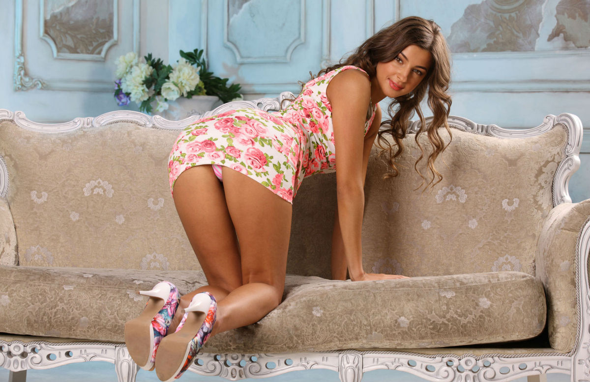 Masha E exposes her tanned body on sofa 1