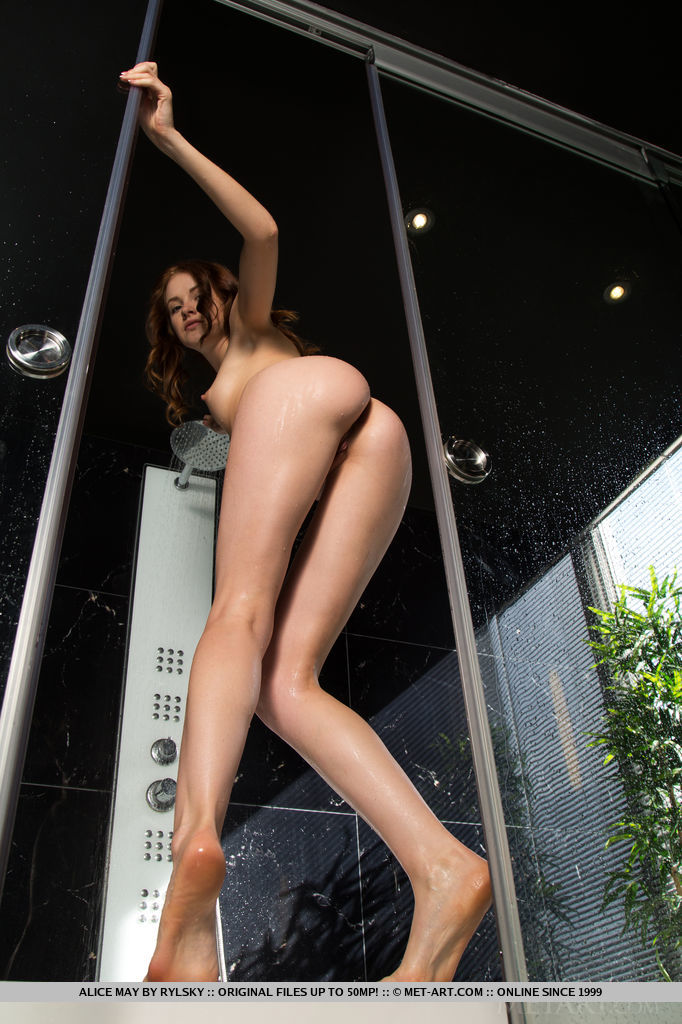 Alice May plays in the shower baring her slender body.