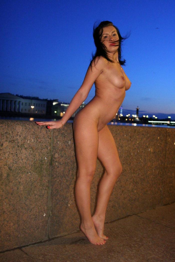 Brunette with super hot assets on the evening quay