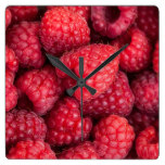 Fresh red raspberries square wall clock