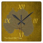 Vintage dusty grey dry leaf on yellowish brown square wall clock