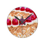 Frankfurt crown cake with cherries on rustic wood round wall clock