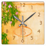 Monogrammed pink roses on a garden wall square wall clock