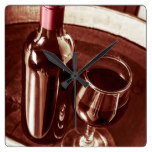 Old wine bottle and glass in rustic wine cellar square wall clock