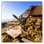 Old stone coastal boat house square wall clock