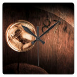 Vintage scotch whisky on wooden tabletop square wall clock
