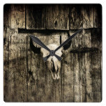 Rustic buffalo skull with horns on a barn square wall clock