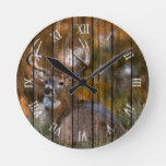 Stag Resting in Autumn Field On Wood Round Clock