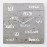 Modern beach driftwood ocean sea typography square wall clock