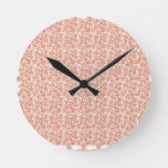 pink and white pattern round clock