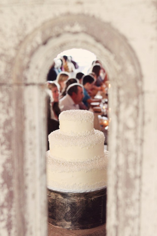 Old wooden doors lined the wall behind the cake table