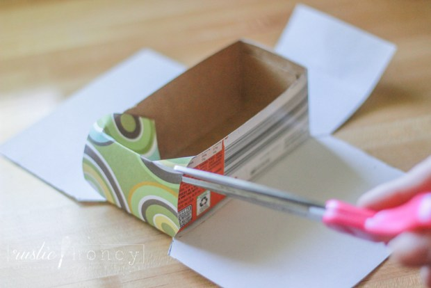 recycled boxes into covered drawer organizers